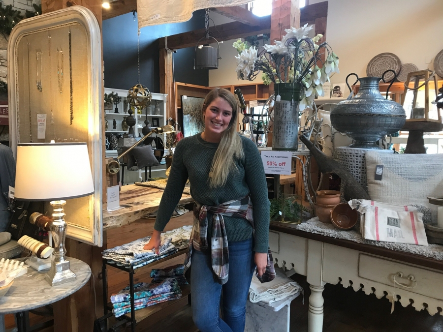 girl standing in a retail store with home decor
