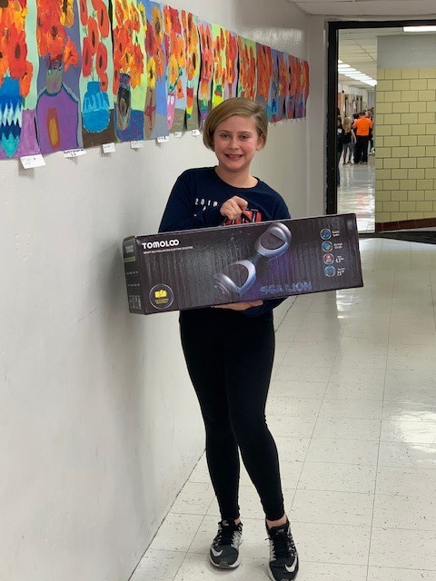 girl holding hover board box