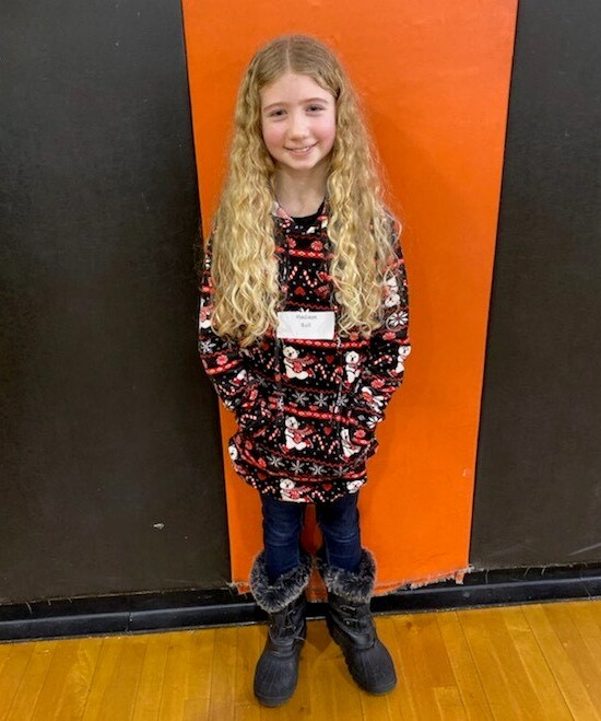 girl standing in front of orange and black