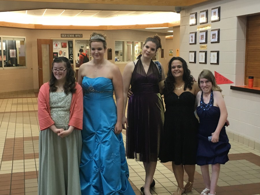 girls all smiling and wearing dresses