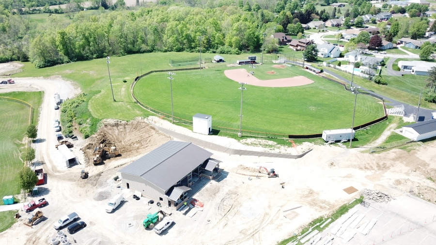 wide angle of a new construction with a baseball diamond