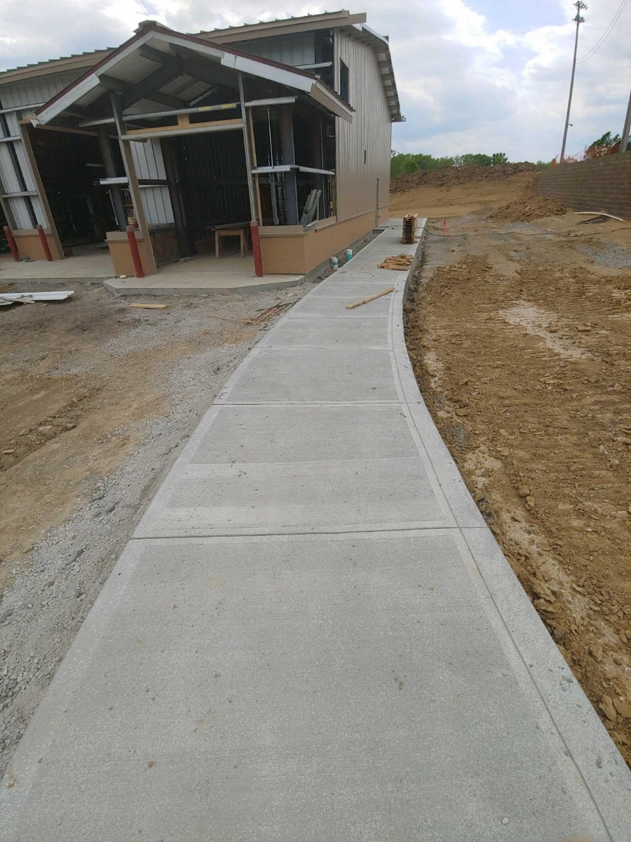 finished sidewalk on a new construction site