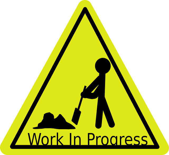 yellow triangle with worker